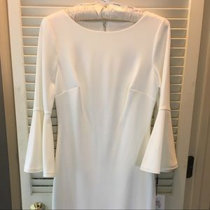 Brand new Calvin Klein dress with bell sleeves.